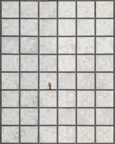 Aerial View Of Woman Walking On Tiled Floor