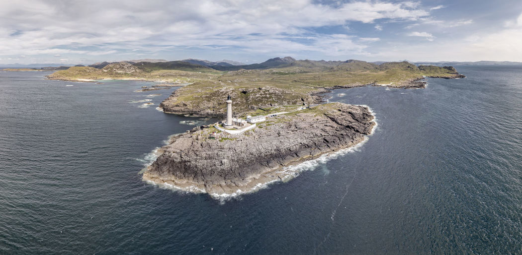 Stunning aerial shot of Ardnamurchan Point, Great Britains most westerly point, with lighthouse and the beautiful white beaches and costline in the background, Scotland Ardnamurchan Holiday Lighthouse Rock Scotland Scotland 💕 Scottish Security Stunning Aerial View Beach Coast Europe Highlands Of Scotland Historic Landmark Monument Peninsula Point Safety Tower Travel Destinations Vacation West Coast Wild