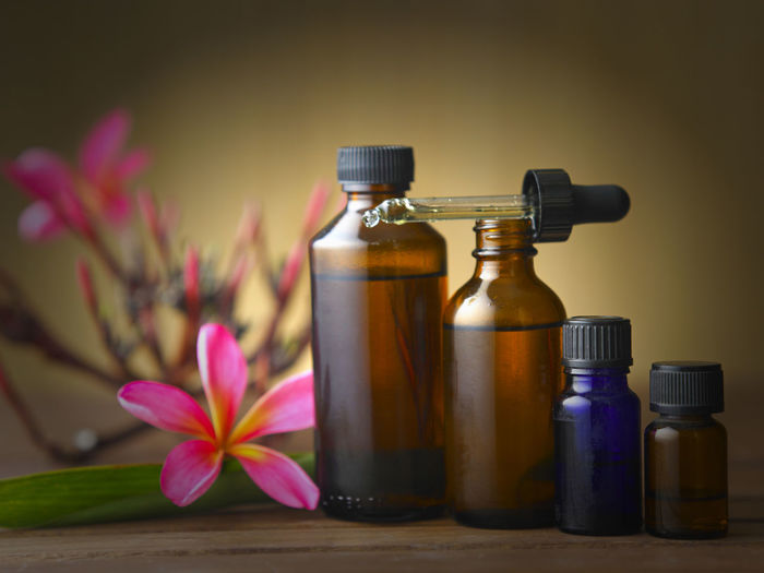 aromatherapy bottles with flower Frangipani Pink Alternative Medicine Aroma Aroma Therapy Bottles Close-up Day Essential Oils Flower Flower Head Freshness Indoors  Massage Oil Nature No People Pink Flower Relax Scented Spa