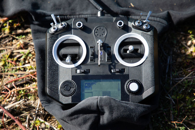 High angle view of remote control on field