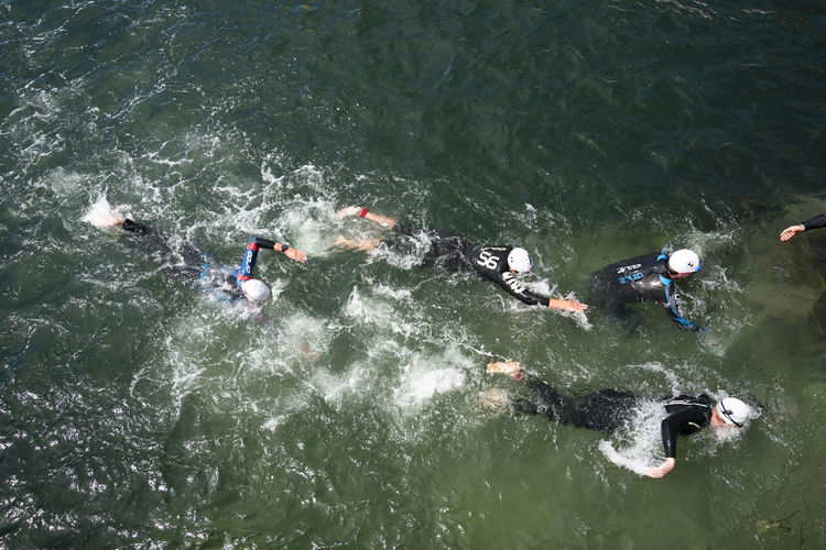 High angle view of people in a swim race in sea