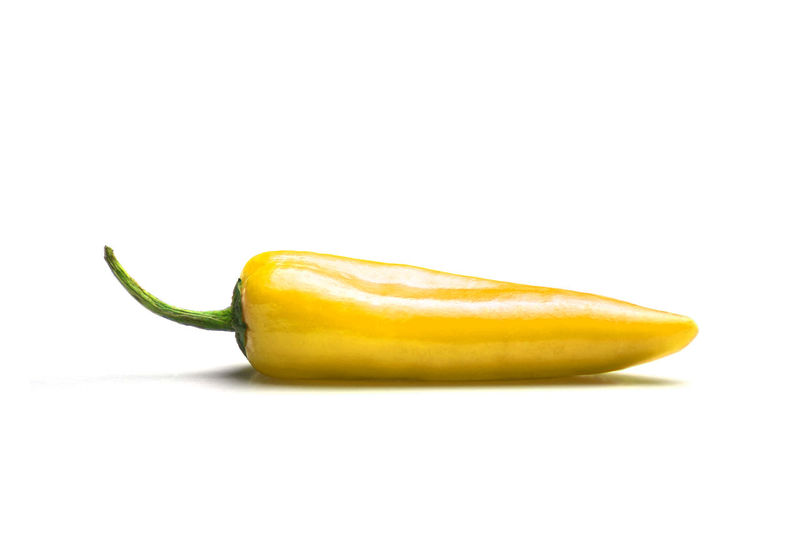 Close-up of Yellow hot Pepper isolated on white background. Wellbeing Ripe Chili Pepper Green Color No People Copy Space Still Life Single Object Close-up Cut Out Yellow Fruit Indoors  Freshness Healthy Eating Studio Shot Food And Drink Isolated White Background Spicy Spices Spicy Food Healthy Food Raw Raw Food Vegetable Pepperoni Pepper - Vegetable Pepper Indoors