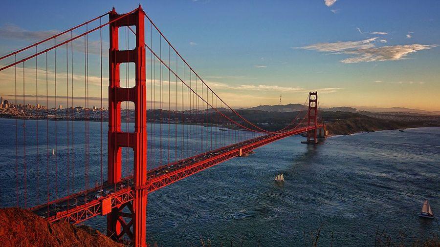 Golden gate bridge against sky during sunset