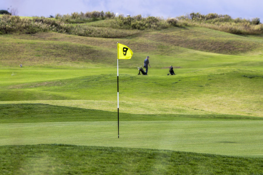 Competition Day Flag Golf Golf Club Golf Course Golf Flag Golfer Grass Green - Golf Course Green Color Leisure Activity Lifestyles Nature One Man Only One Person Outdoors People Putting Putting Green Real People Sport Sportsman