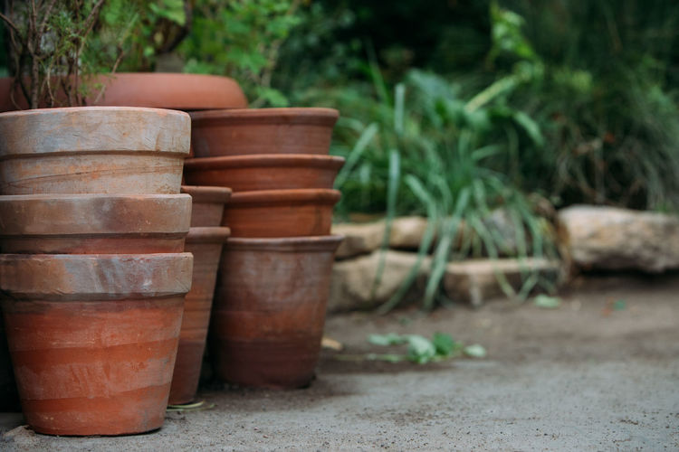 Stack of potted plants in yard