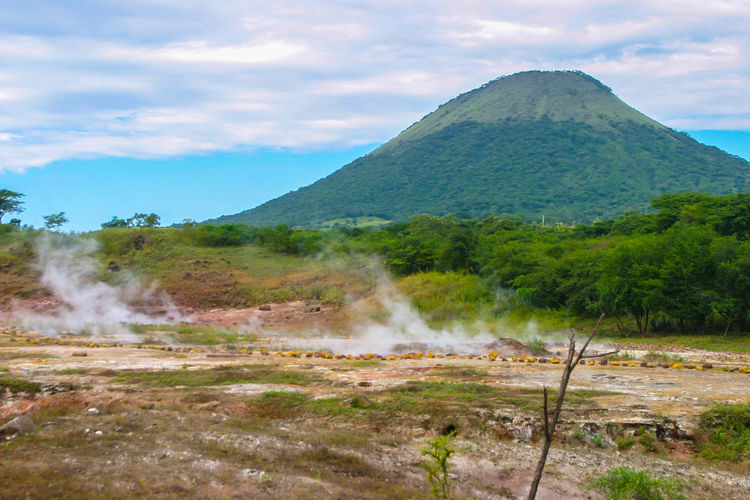 Cloud - Sky Day Erupting Geyser Hervideros Landscape Mountain No People Outdoors Sky Smoke - Physical Structure Tranquility Volcanic Landscape