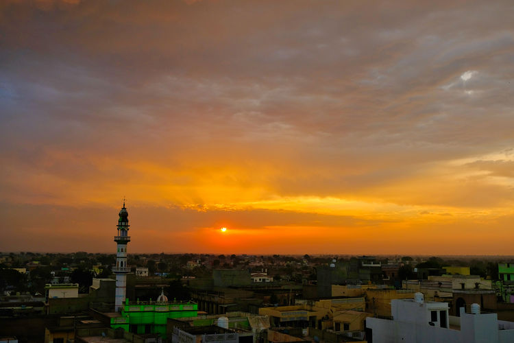 Sunset over old town old Mandawa, India. ASIA India Mandawa, Rajasthan Old Town Architecture Belief Building Building Exterior Built Structure City Cityscape Cloud - Sky Mandawa Nature No People Old City Orange Color Outdoors Residential District Romantic Sky Sky Spire  Sunset Tourism Tower Travel Travel Destinations