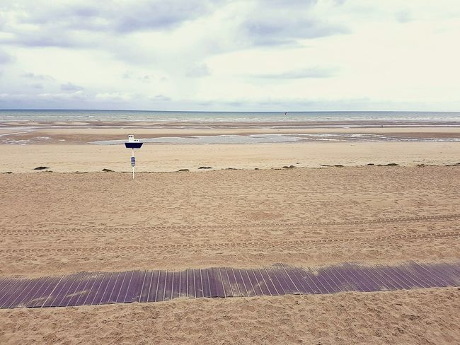 White Sand Beach By The Seashore, Where Everything Seems Calm And Relaxing..  By The Seashore Le Touquet Le Touquet Beach Pas De Calais Normandie, France Plage Cloudy Skies Cloudy