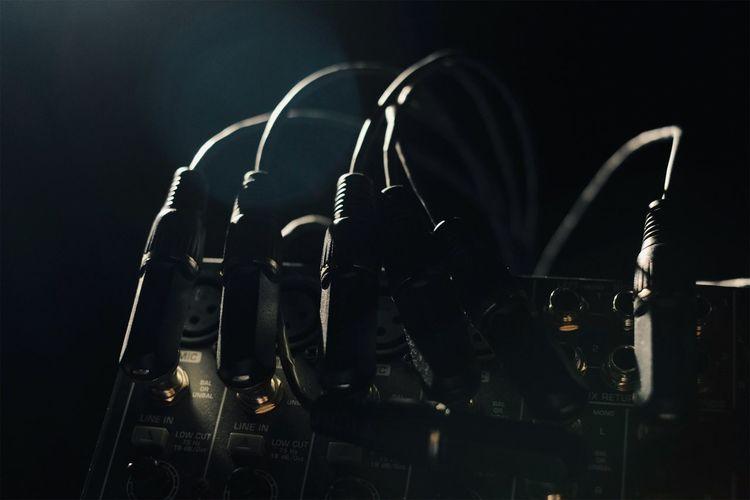 Close-up of audio equipment in darkroom
