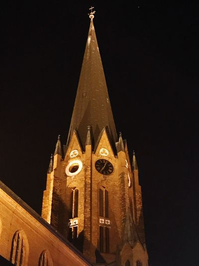 Religion Place Of Worship Spirituality Architecture Building Exterior Built Structure Night No People Tower Cross Low Angle View History Clock Tower Bell Tower Illuminated Outdoors Sky Clock