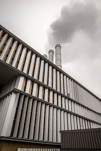 Power plant built with captivating lines. Chimneys Power Plant Architecture Building Exterior Built Structure Day Factory Industry Low Angle View No People Outdoors Sky Smoke Stack Urban The Graphic City