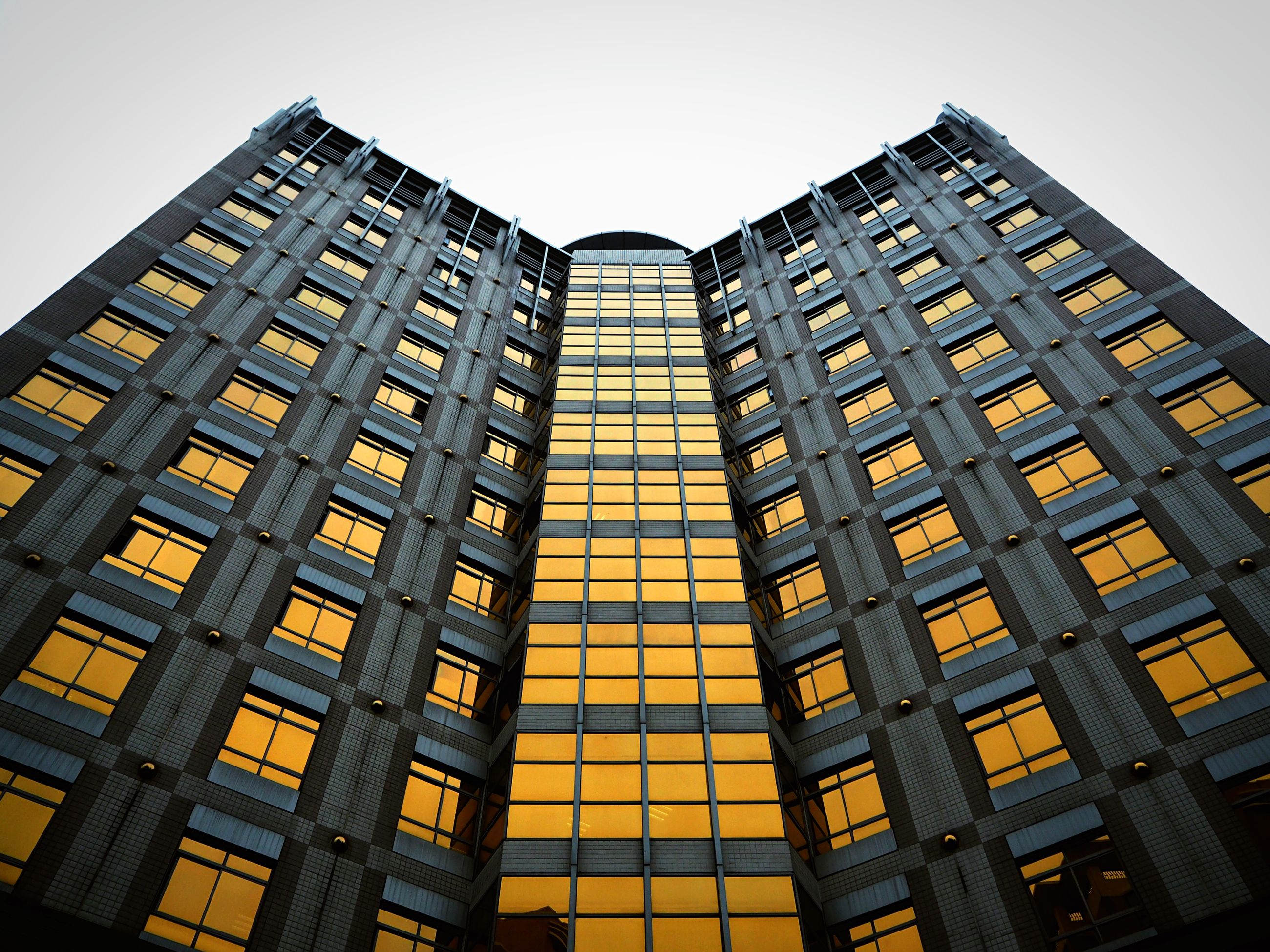 architecture, building exterior, built structure, low angle view, window, city, clear sky, building, tall - high, modern, office building, sky, skyscraper, tower, glass - material, outdoors, day, no people, residential building, apartment