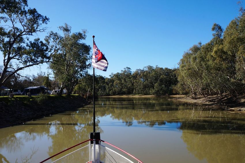 EyeEm Nature Lover EyeEm Best Shots Boat Tree EyeEm Selects Australia Australian Landscape Tree Water Clear Sky Lake Flag Reflection Sky National Icon Flag Pole
