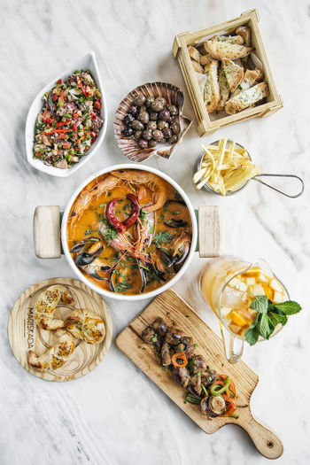 portuguese seafood meal set on table Meal Seafood Tapas Close-up Day Directly Above Food Food And Drink Freshness Gourmet Gourmet Food Healthy Eating High Angle View Indoors  No People Portuguese Food Ready-to-eat Seafood Set Meal Table Variation