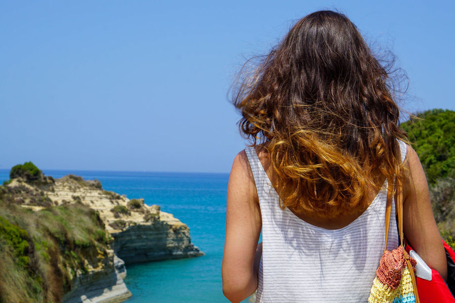 Beauty In Nature Blue Canal D'Amour Casual Clothing Clear Sky Cliff Getting Away From It All Horizon Over Water In Front Of Long Hair Medium-length Hair Nature Non-urban Scene One Young Woman Only Person Redhead Scenics Sea Sidari Standing Straight Hair Tranquil Scene Tranquility Vacations Water