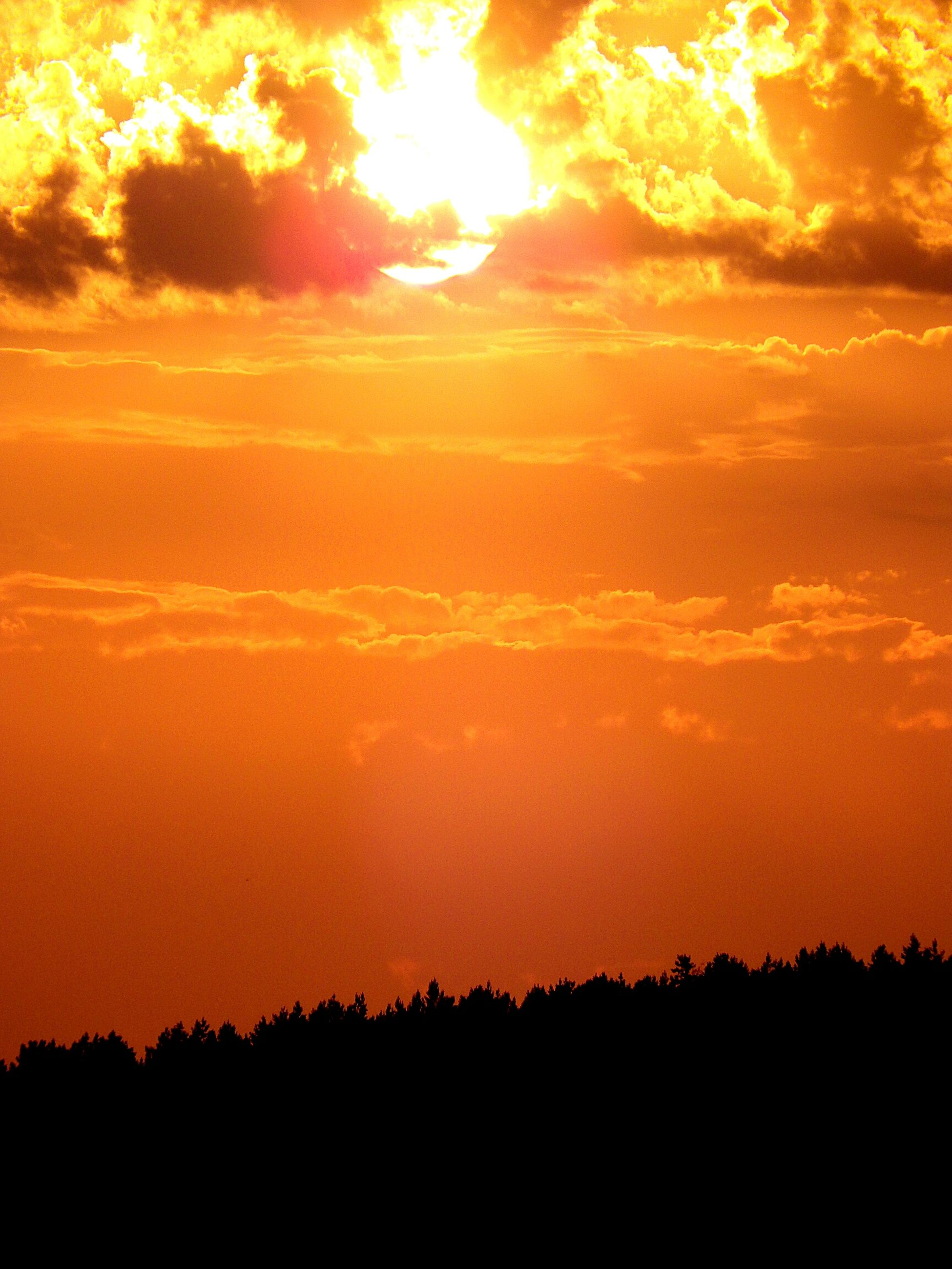 sunset, orange color, silhouette, scenics, beauty in nature, sky, tranquil scene, tranquility, idyllic, cloud - sky, nature, dramatic sky, landscape, sun, majestic, cloud, outdoors, no people, moody sky, cloudy