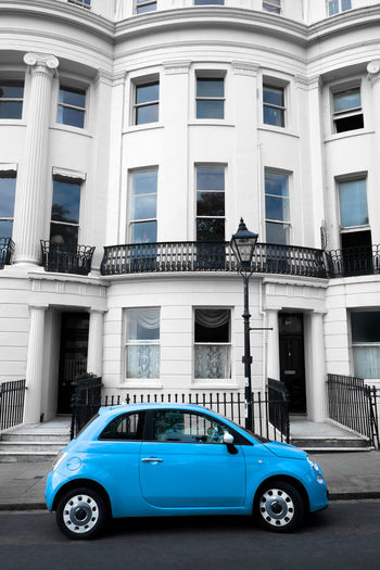 White British regency townhouse with a blue fiat500 car parked in front and a victorian lamp post Blue Car Blue Cars Brighton And Hove Brighton Uk British Architecture City Life City Life. City Street Cool Britania🇬🇧 Cool City Fiat Fiat500 Historical Building Historical Buildings Ironwork  Railings Regency Regency Architecture Town Square Townhouse Urban