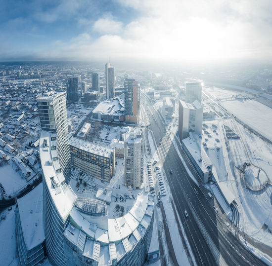 Vilnius city downtown district at winter, aerial view Vilnius Vilnius, Lithuania Lithuania Lietuva City Downtown District Skyscrapers Winter Cold Temperature Snow Cold Ice Sunrise Sunny Bussiness Financial District  Cityscape Skyline Architecture High Rise Apartment Office Building Office Aerial View Aerial Aerial Photography