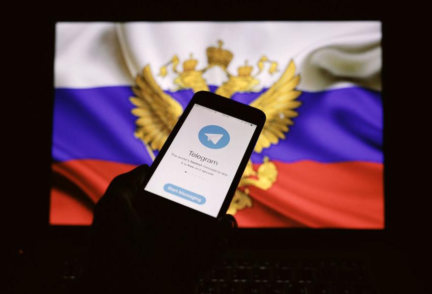 Telegram messenger application displayed on the screen of a smartphone. App Application Double Eagle Logo National Emblem Ribbon Russia Flag Screen Telegram Tricolor Messenger Smartphone Social Media