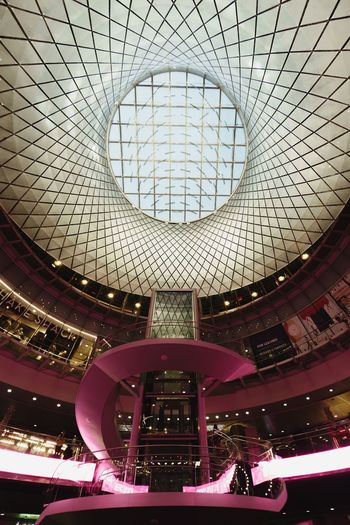 Indoors  Ceiling Architecture Low Angle View Built Structure No People Pattern Transportation Glass - Material Day Geometric Shape Shape Modern Illuminated Shopping Mall Mode Of Transportation Circle Skylight Design Architectural Feature