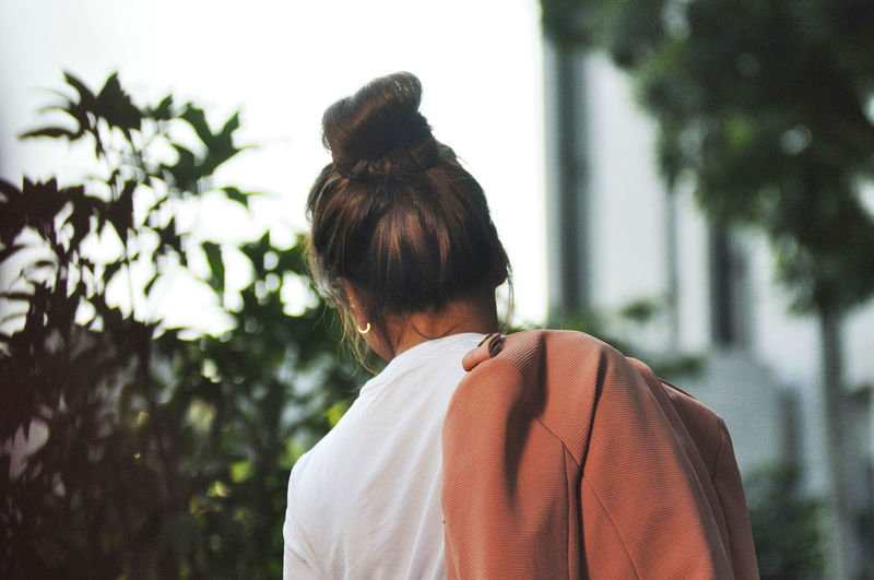 Rear view of woman looking at tree
