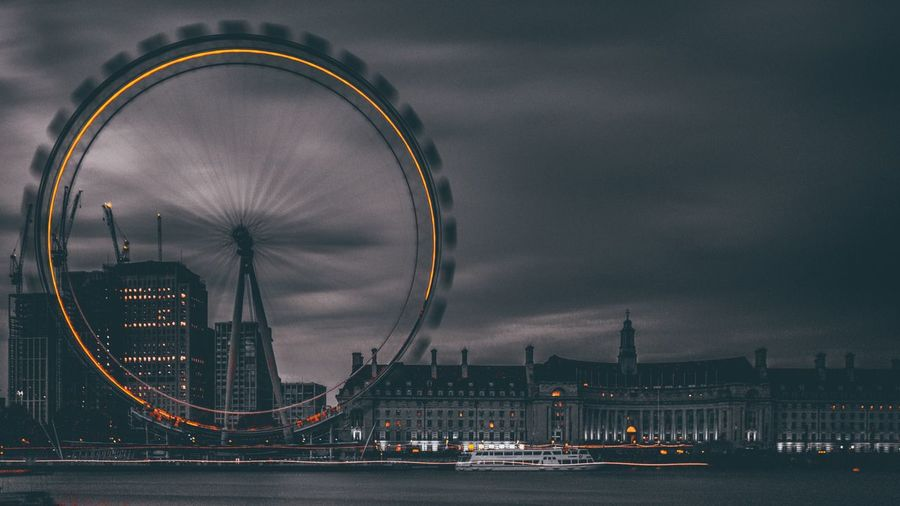 Millennium wheel in city at night