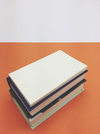 stack of books Knowledge Reading A Book Orange Color Stack Of Books Books Copy Space Studio Shot No People Close-up Indoors  White Background Day