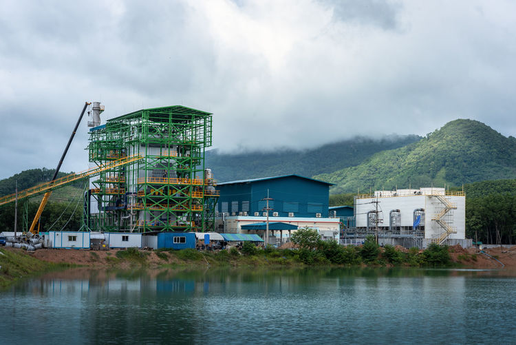 Power Plant Architecture Biomass Building Building Exterior Built Structure Cloud - Sky Day Industry Lake Mountain Nature No People Outdoors Sky Travel Travel Destinations Water Waterfront