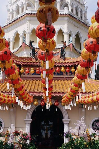 Low angle view of lanterns hanging in temple