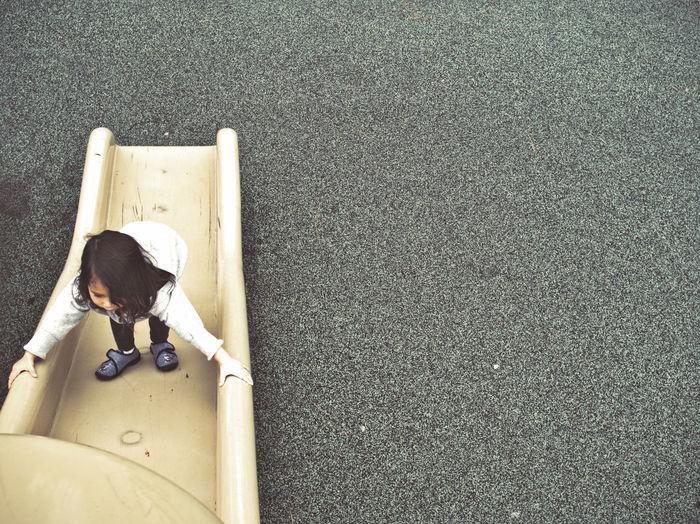 High angle view of girl on slide