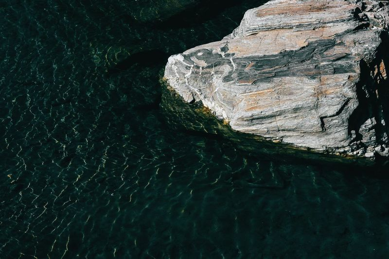 Elevated view of rock in water