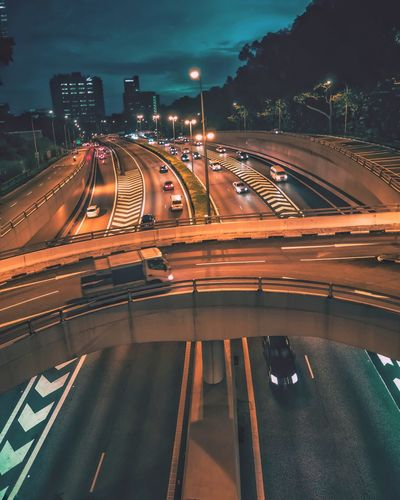 High angle view of cars on road at night