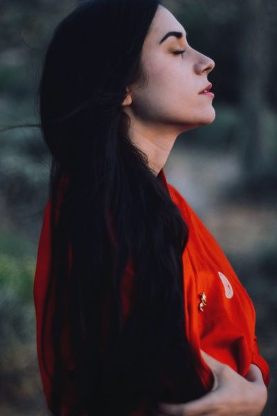 The Portraitist - 2017 EyeEm Awards Side View One Person Real People Lifestyles Outdoors Young Women Young Adult Day Beautiful Woman Close-up Nature Sunset