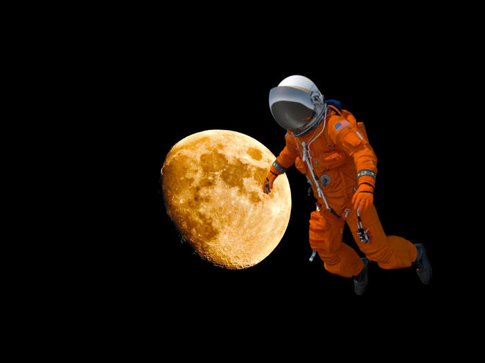 Astronaut Arts Culture And Entertainment Black Background Copy Space Cut Out Dark Food Food And Drink Freshness Holding Indoors  Music Musical Equipment Musical Instrument One Person Orange Color Playing Skill  Still Life Studio Shot