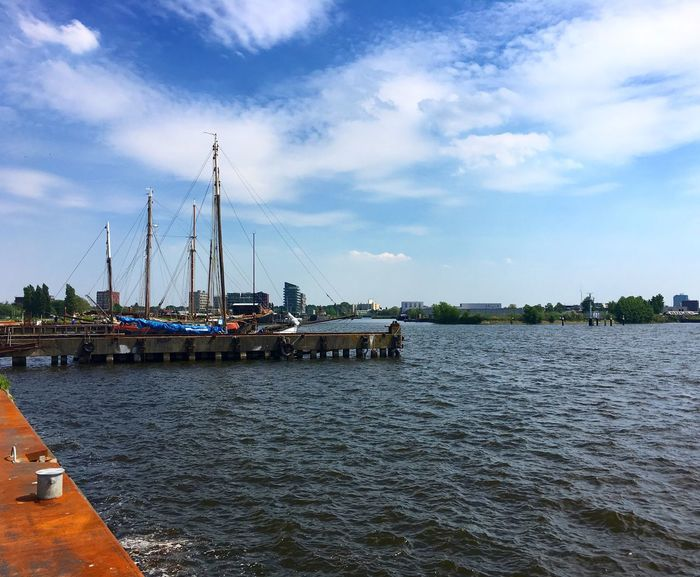 The view during lunch. Not bad while in the middle of Amsterdam. Nautical Vessel Sky Cloud - Sky Water Transportation Mode Of Transport Day Outdoors Built Structure Harbor Nature Architecture Sailboat Moored Ship Mast No People Sea Travel Destinations Scenics Amsterdam Pllek Lunchtime