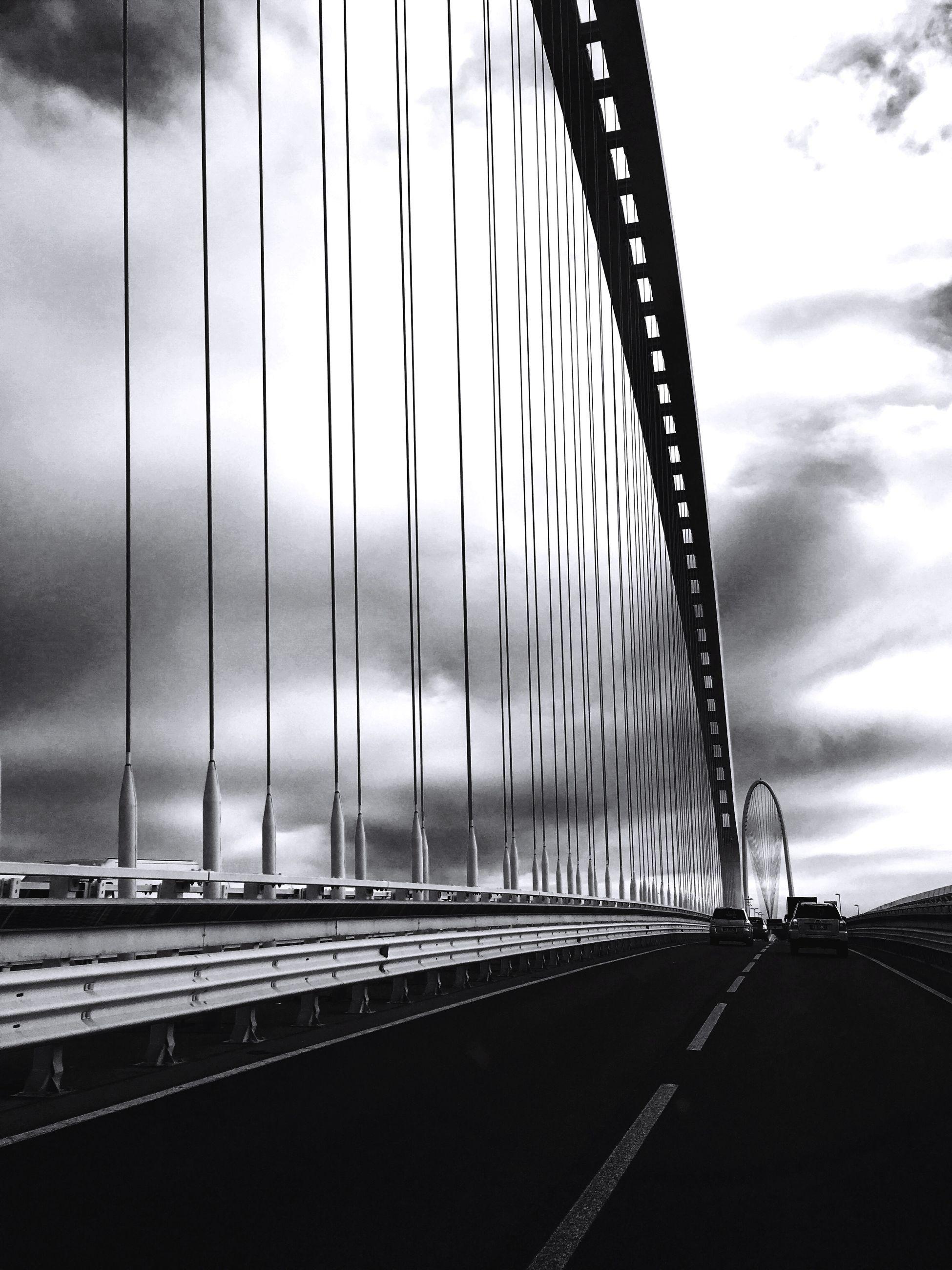 bridge - man made structure, sky, built structure, outdoors, connection, architecture, no people, day, suspension bridge