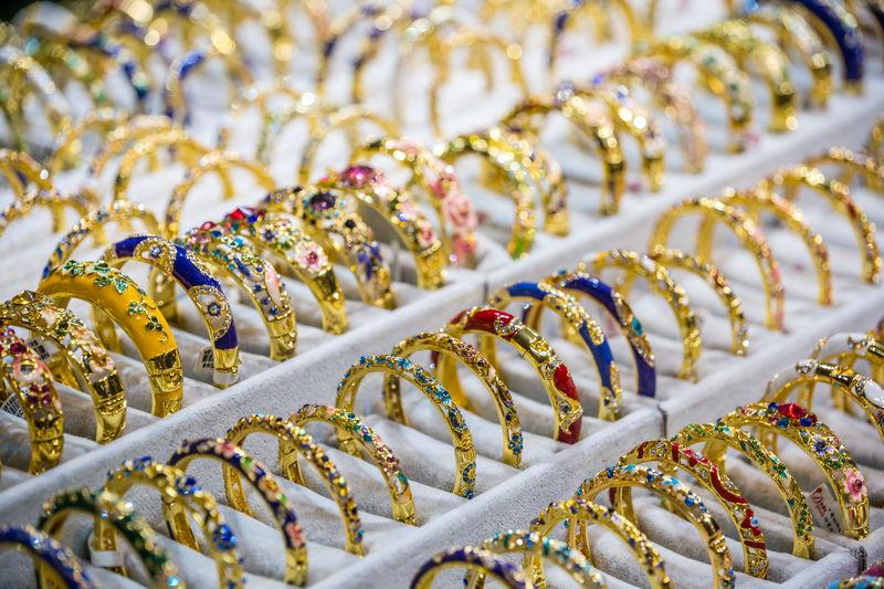 Full frame shot of gold rings for sale