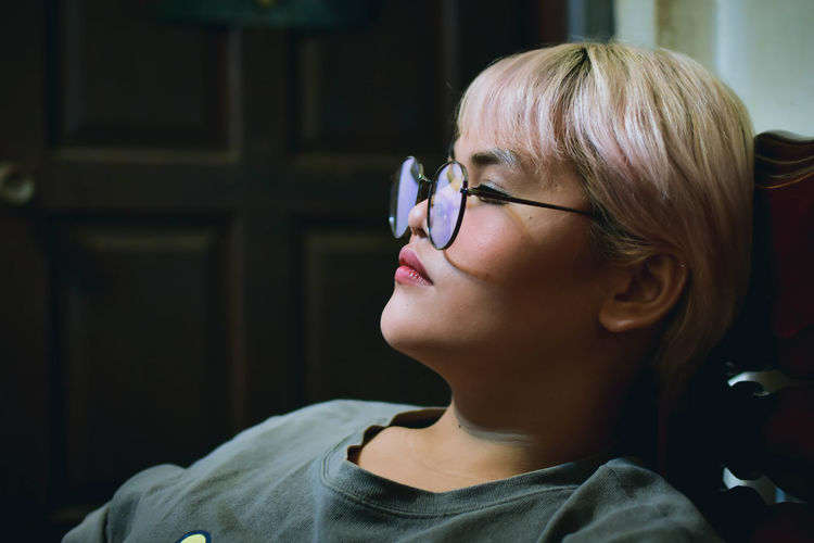 Close-up of young woman relaxing at home