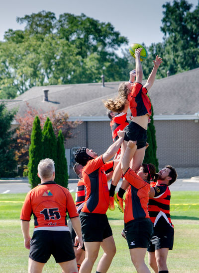August 2017; two teams demonstrate how rugby is played at the Kalamazoo Scottish festival in Michigan USA Diversity Fun Happy Hot Rugby Ball TEAMS Uniform Active Adults Casual Clothing Clothing Clothing Store Competition Day Female Group Of People Lift Men Nature People Play Rugby Skirmish Sport Women Go Higher Human Connection