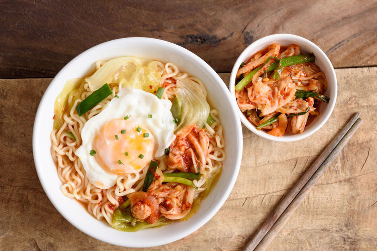 Kimchi noodle soup Food Food And Drink Healthy Eating Bowl Ready-to-eat Kitchen Utensil Freshness Directly Above Table Vegetable Indoors  Wellbeing Meat Eating Utensil Spoon No People Still Life High Angle View Wood - Material Asian Food Chinese Food Korean Food Kimchi Noodles Instant Noodles Ramyeon