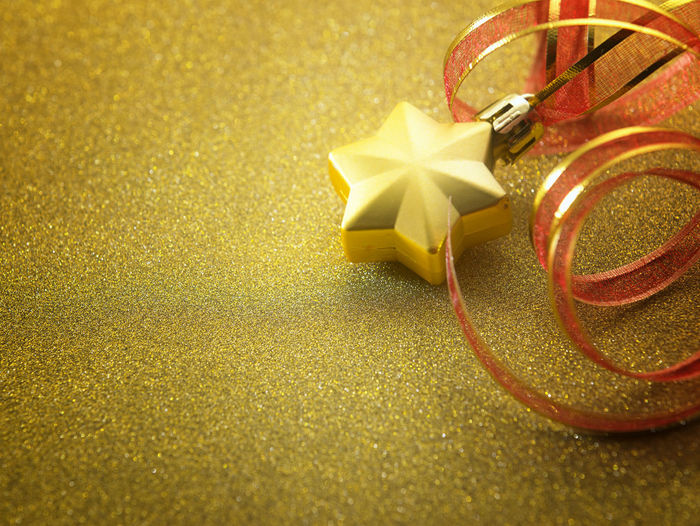 Close-up of christmas decoration on golden table