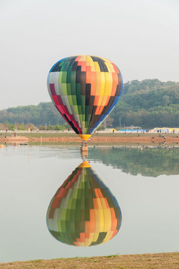 Balloon in the sky. ( sky not bright and Cloudy skies) Balloon Beauty Day Hot Air Balloon Lake Mountain Multi Colored Nature No People Outdoors Reflection Sky Water