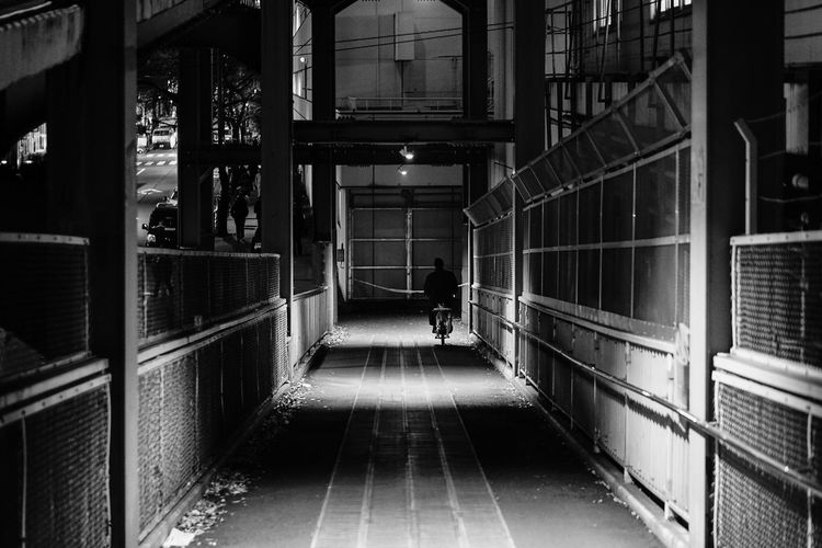 Architecture Building Built Structure Direction Full Length Illuminated Indoors  Lifestyles Men One Person Public Transportation Railing Real People Rear View The Way Forward Transportation Unrecognizable Person Walking HUAWEI Photo Award: After Dark EyeEmNewHere