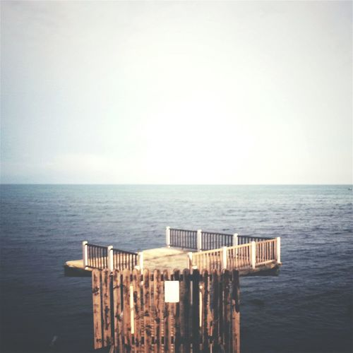 High angle view of diving platform by sea against sky