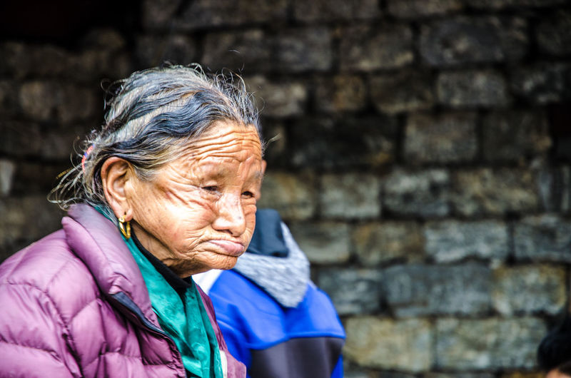 Blue Casual Clothing Close-up Day Focus On Foreground Headshot Human Face Leisure Activity Lifestyles Nepalipeople😊 Outdoors Portrait Relaxed Lady ...love Her Face Structures From Which You Can See That She Was Having A Rough Life... The Portraitist - 2016 EyeEm Awards My Year My View
