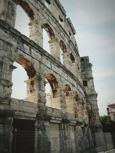 EyeEmNewHere Old Ruin Architecture History Travel Destinations Ancient Built Structure Arch Ancient Civilization Cloud - Sky Business Finance And Industry Sky Day Outdoors Building Exterior No People Amphitheater Be. Ready. EyeEm Ready   AI Now