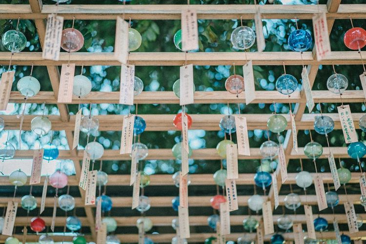 Wind Chimes Wind Chime Full Frame Backgrounds No People Day Pattern Architecture Wall - Building Feature Outdoors Multi Colored Close-up Wood - Material Built Structure Window Side By Side Creativity Wall Nature Low Angle View Textured  Focus On Foreground