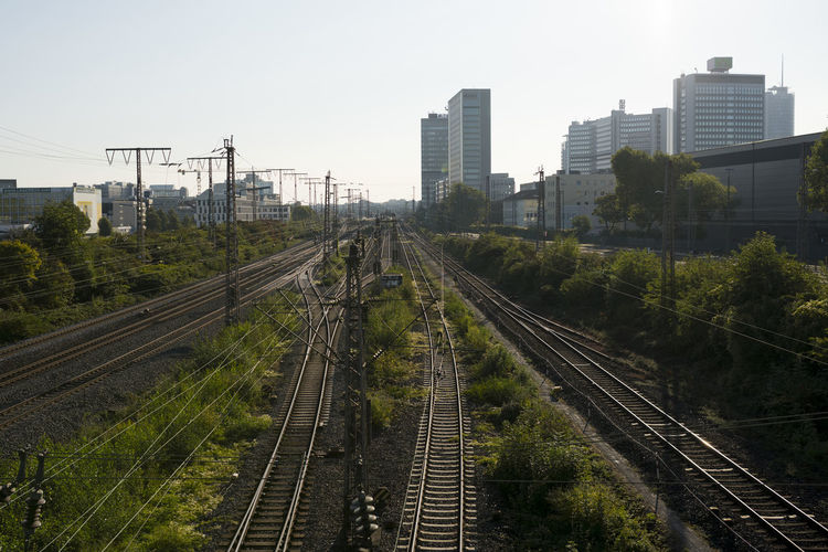 #urbanana: The Urban Playground Essen Ruhrgebiet Sunlight Architecture Donwtown Electricity  Mode Of Transportation No People Office Building Office Building Exterior Outdoors Plant Public Transportation Rail Transportation Railroad Track Track Transportation