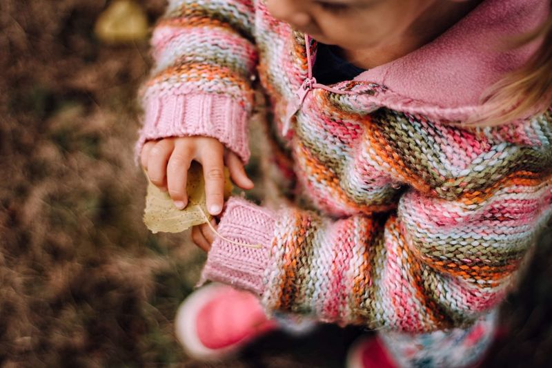 Real People One Person Close-up Leisure Activity Focus On Foreground Childhood Warm Clothing Outdoors Lifestyles Girls Day Wool Young Adult Human Hand People Adult