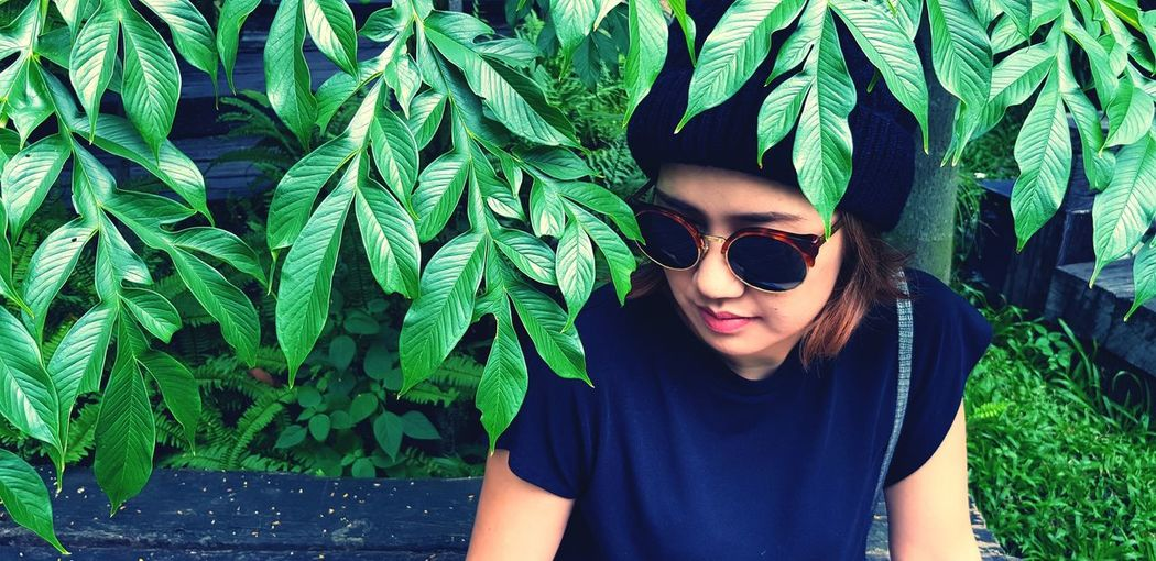Woman in nature Black Fashion Black Glasses Nature Forest Green Leaves Hipster Face People Young Women Portrait Looking At Camera Headshot Leaf Front View Sunglasses Green Color Close-up Pretty HEAD Wearing Cool Profile Tree Trunk Fallen Tree